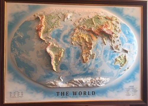 3D Wall relief map of the World. All names in English. A high raised relief panorama.